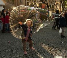 The moment a huge bubble bursts in Paris, France.