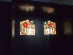 Stained glass with rose emblems in House for an Art Lover - CR Mackintosh
