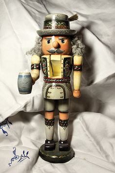https://flic.kr/p/5VDueB | German Nutcracker | One of my talented sister's painted nutcrackers portraying our german heritage. She likes to paint in the Rosemaling and Bauernmalerei techniques.