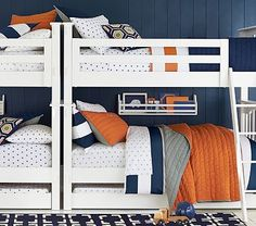 Love the colors and patterns here... Only I would swap out red in place of the orange. Also love the hints of green . . . the white bunks look great with all the colors.