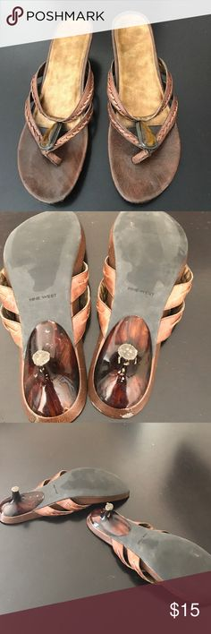 Nine West size 10 brown kitten heel sandal These sandals have a few scuffs on the tortoise heels and on the back of each shoe, but are in otherwise good condition. Brown tiger-eye looking decoration on the front of the sandal. Nine West Shoes Sandals