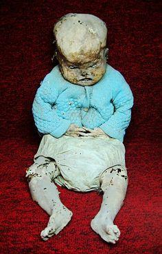 Creepy mummified baby
