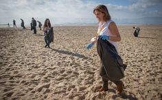 Liberal Democrats supporters take part in a beach clean on the second day of the Liberal Democrats annual conference on September 20 2015 in.