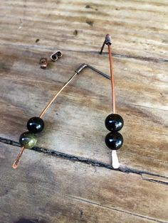 A personal favorite from my Etsy shop https://www.etsy.com/listing/508967629/simple-black-gold-obsidian-earrings