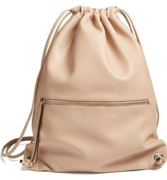 Add a contemporary-chic element to the street style with this pared-down sling backpack in smooth faux leather.