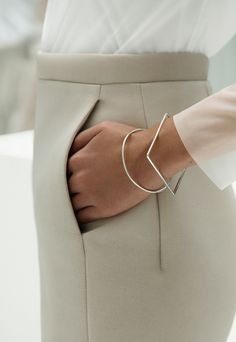 beige work pants | pleats | white layered sheer blouse | round and square gold bangles