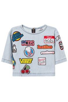 GCDS PATCH CROP DENIM LOGO TOP Light washed patch crop denim logo top. Made in Italy. 100% cotton SIZE & FIT Fits true to size. GCDS Quality oversized tees and sweaters dripping with dope graphics shouting out to a spectrum of sporting subcultures.