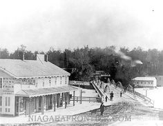 the Tugby and Walker Variety Store, circa: 1870's-1880's. The variety store was located on the main land of Manchester (Niagara Falls, New York) beside the Goat Island Bridge leading to Bath Island. The small white house on Bath Island is a bath house for which the island was named.