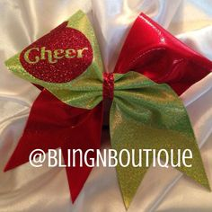 Neon lime green holographic dot mystique tic toc'd with red mystic with a red Christmas ornament on the green loop with Cheer peeping through and a red glitter center. BlingNBoutique bows are handmade