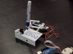Plotclock is a robotic clock that uses an arm to write the time on a mini whiteboard with a dry erase marker. After it writes out the time, it erases the numerals with an eraser and begins anew. Pl...