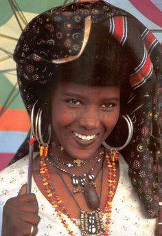 afrikanattire:  I like the way Wodaabe women wear multiple earrings and necklaces