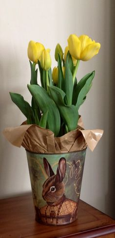 Tulips in a bunny container~so cute