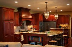 Pretty cherry kitchen - My dream kitchen!!! First one I have seen on here that is not stark white! I love the dark wood in a kitchen, it feels inviting