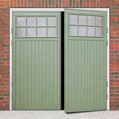 Side hinged garage doors are incredibly popular for those who prefer pedestrian . Door Makeover, Sliding French Doors Patio, Side Hinged Garage Doors, Garage, Shed Doors, Garage Door Makeover, Doors, Garage Door Types, French Doors Patio
