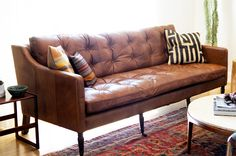 I adore this couch. The leather brings masculinity, while the structure is…