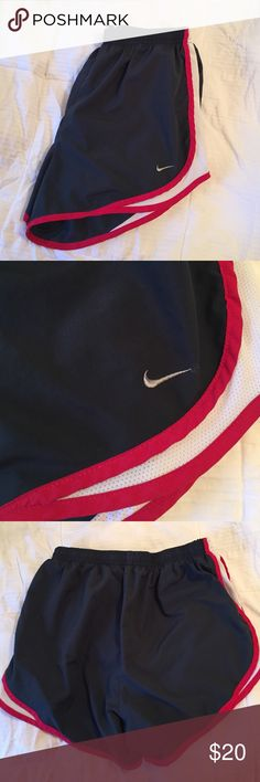 Nike running shorts Gray-ish blue, white and red Nike running shorts. Lined. Size Medium. No stains, odors, tears or holes. Nike Shorts
