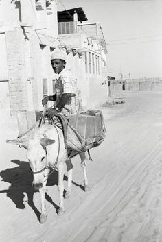 Water Porter, Dubai, 1960s. The Occupations Series.     © Noor Ali Rashid Archives | The National