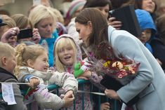 Catherine, Duchess of Cambridge receives flowers from a wellwisher during her visit to Pembroke Refinery on November 8, 2014 in Pembroke, Wales.