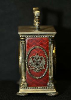 Fabergé carriage clock with diamond encrusted border around clock face, in original Fabergé box. Workmaster Erik Kollin (1836-1901). Side view.