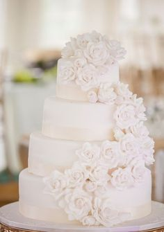 Classic four tier wedding cake with white rose cake flowers; Featured Photographer: Kane and Social
