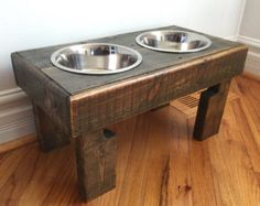 Up for sale is a rustic dog bowl feeding stand I built from a reclaimed pallet. I custom build any size and color you need. The one pictured has a chestnut finish with a coat of pet friendly sealer. Measures 21 long X 11 wide X 11 tall. It also comes with 2 brand new stainless steel bowls and i can solder your pets name on the wood at no additional charge.If you have any questions you can call, text or email. 5742490308