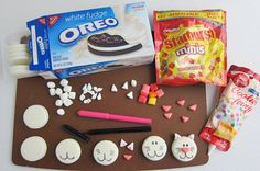 Turn white chocolate fudge Oreo Cookies into adorable Oreo Cats for a cat lover's birthday party, a pet adoption, or a fun afternoon snack.