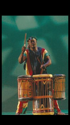 """Mangue Sylla a native of Conakry, West Africa, began establishing his track for music at the age of 7. He is electrifying on the doundoun set (doundoun, sangban and kenkeni) as noted in this photo.  Sylla learned the """"ballet style"""" of playing drums while working with the famed group Percussions De Guinee """"he is as equally accomplished in traditional style"""". Come, learn and share in his mastery of the drums as he instructs at the Florida African Dance Festival for the 14th year."""