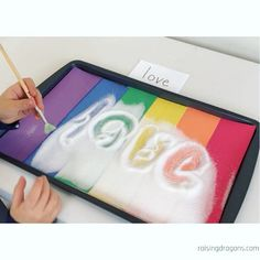 Rainbow Salt Writing Tray * ages ⋆ Raising Dragons This rainbow sensory writing tray makes practicing writing so much fun for preschoolers and kindergarteners!Sensory writing trays are a great way to get kids excited about learning letters, numbers, sha Preschool Writing, Homeschool Kindergarten, Preschool Learning Activities, Preschool Crafts, Toddler Activities, Teaching Kids, Homeschooling, Carnival Activities, Child Development Activities