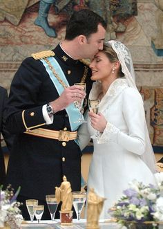 Princess Letizia was all smiles as she toasted alongside her new husband.