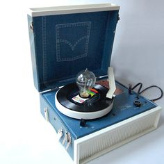 I had a record player that looked like this, minus the weird lamp bit.