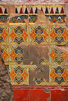 isis0isis: Old, broken tiles in a street wall in Havana by Peter Q on Flickr.