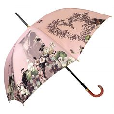 "This new creation by French umbrella designer Guy de Jean is a romantic umbrella evoking ""La Belle Epoque"" and the Eiffel Tower in a vintage-inspired design. Choose between 3 soft colors."
