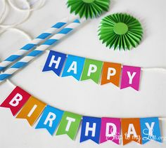 Free birthday cake bunting banner. Or google others, there are lots o free banners and cake toppers out there.