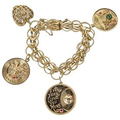 1950s Gold Multi Charm Bracelet With Cartier Charm | From a unique collection of vintage charm bracelets at https://www.1stdibs.com/jewelry/bracelets/charm-bracelets/