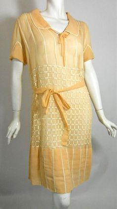 Softest apricot cotton voile 1920s dress with embroidered open work design. Self sash, tie at neckline, peaked cuffs on sleeves. No closure.