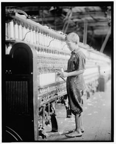 a barefoot young boy at work. 1910 Clarence Wool by Lewis Hine