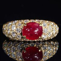Stunning Vintage Cabochon Ruby and Diamond Ring in 18k Gold by VictoriaSterling on Etsy https://www.etsy.com/listing/197478455/stunning-vintage-cabochon-ruby-and