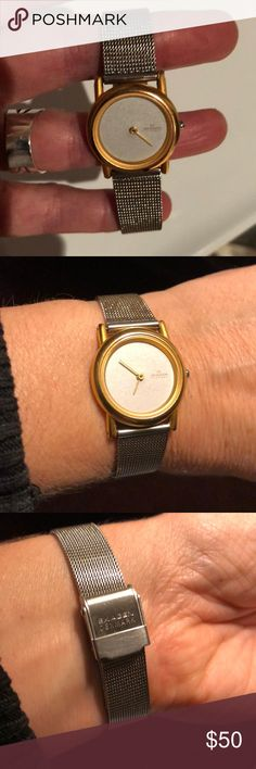 Skagen modern watch in stainless and gold Clean, modern, timeless Scandinavian style in this Skagen stainless and gold tone watch with mesh band. Vintage 1990s, but put brand-new battery in it today! Skagen Jewelry Bracelets
