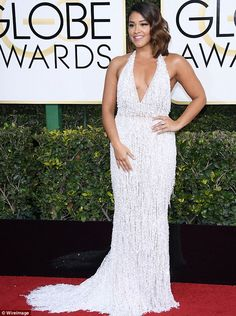 Glamorous look: Gina Rodriguez opted for old-school Hollywood glamour on Sunday for the Go...