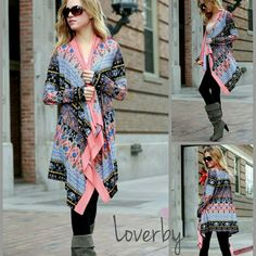 Coral Print Draped Cardigan Beautiful draped cardigan with coral trim and multicolor print. Very soft to the touch and flows perfectly! This cardigan is brand new with Loverby Boutique tags.   Small sizes 2-6, Medium size 8-10    Thank you for visiting!  Sweaters Cardigans