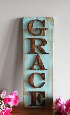 This will be a perfect touch to your shabby chic home decor. All hand made and finished. Each one is made to order - one at a time - just for you. The back board is reclaimed pallet wood painted a antique turquoise distressed color with letters of Grace cut out of solid oak. Measures approx 5 inches wide by 16 inches long. Each one is handmade just for you, one at a time. Please allow 2 weeks production time.