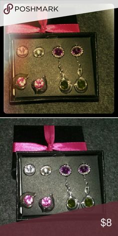 New Avon Earrings 4 pair of lovely earrings on siler studs never worn.. Comes with box please ask any questions and thanks for stopping by!! Avon Jewelry Earrings