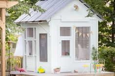 An Amazing Kids' Playhouse Built from an Old Backyard Shed - behr aqua smoke paint color