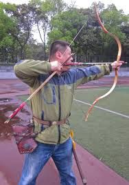 """traditional Chinese archery - notice that the arrow is placed on the """"outside"""" of the bow!"""