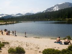 There is a place in this pristine park, best known for its mountains and alpine tundra, where you can bring a swimsuit and walk barefoot across a beach.