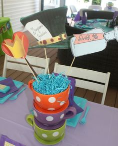Centerpieces... Very similar to what I was thinking, but with tea cups.