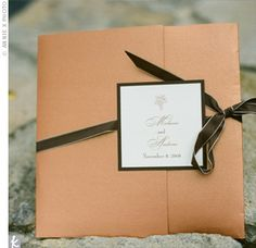 Melanie and her mother custom-designed the wedding invitations, and the colors they chose (copper and brown) inspired the palette of the entire wedding.