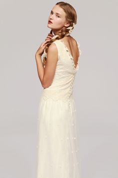 MAIA is a very popular wedding dress due to its details across the plunge v-neck line and its simplicity. The back of the same style gives it a sexy touch and the bottom has a layer of lace with delicate flowers throughout and a beautiful pattern at the very bottom where this wedding gown touches the ground. Sleeveless, it looks great with hair accessories and its a great idea for the bohemian bride. This dress will be at our showroom opening in London in Oct 2015.