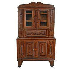 """Tramp Art Cupboard - De accessioned from the Blue Cross Blue Shield of Illinois American Folk Art Collection where it was on display in its Chicago office. It has been published in """"Tramp Art A Folk Art Phenomenon"""" on page 83 and was also illustrated in the catalog, """"American Folk Art."""""""
