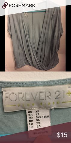 Forever 21 Shirt Cute mint colored forever 21 short sleeved shirt. It crisscross' in the front. Perfect for summer! Forever 21 Tops Tunics